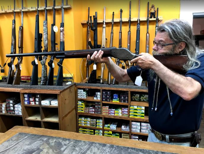 Store owner with shotgun